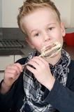 Boy Eating Dough From A Beater Royalty Free Stock Photos