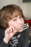 Boy Eating Dough From A Beater Stock Photo