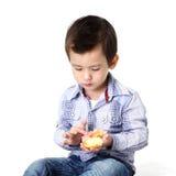 Boy eating dough nut Stock Image