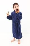Boy Eating Doughnut Royalty Free Stock Photo