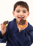 Boy Eating Doughnut Stock Photos