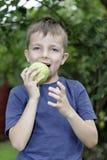 Boy eating a fresh apple Royalty Free Stock Photos