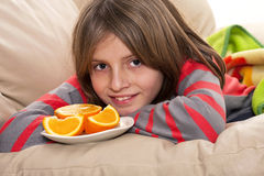 Boy eating fresh oranges Stock Photos