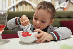 Boy eating fruit ice cream Stock Photo