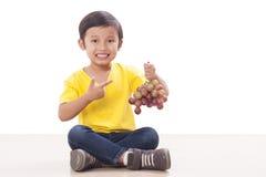 Boy eating grapes Royalty Free Stock Photo