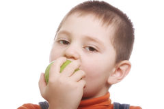 Boy eating green apple Royalty Free Stock Photo