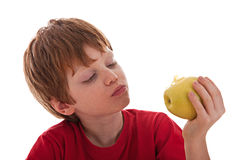 Boy eating a green apple Royalty Free Stock Images