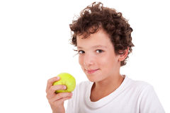 Boy eating a green apple Stock Photo