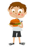 Boy eating hamburger Stock Image
