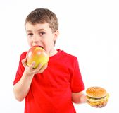 Boy eating a hamburger. Stock Images