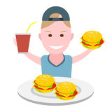 Boy eating a hamburger Royalty Free Stock Photo