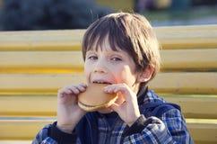 Boy eating a hamburger Royalty Free Stock Photo