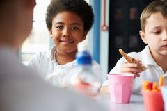 Boy Eating Healthy Packed Lunch In School Cafeteria Royalty Free Stock Image