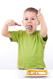 Boy eating healthy salad Royalty Free Stock Photography