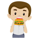 Boy Eating his Hamburger Stock Photography