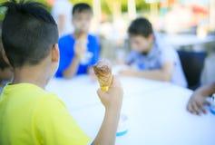 Boy eating his ice cream Royalty Free Stock Photos