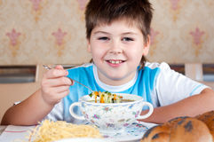 Boy eating homemade noodles Royalty Free Stock Photography