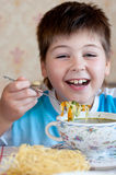 Boy eating homemade noodles Royalty Free Stock Photos