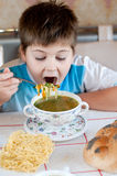 Boy eating homemade noodles Royalty Free Stock Images