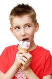 Boy eating ice cream. Eighth year boy eating ice cream isolated on white Stock Photography