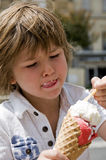 Boy eating ice cream Stock Photo