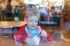 Boy eating ice-cream Royalty Free Stock Photos