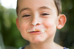 Boy eating ice-cream Stock Image