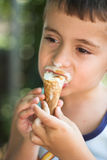 Boy eating ice-cream Royalty Free Stock Photos
