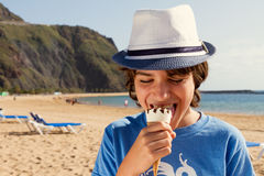 Boy eating ice cream on beach Royalty Free Stock Images