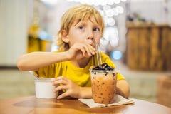 Boy eating ice cream in a cafe stock photos