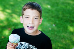 Boy eating ice cream cone Royalty Free Stock Image