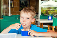 Boy eating ice cream Royalty Free Stock Images