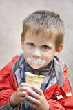 Boy eating ice cream Stock Photography