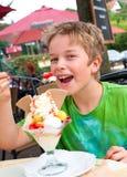 Boy is eating ice cream royalty free stock photos