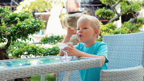Boy eating ice cream. stock footage