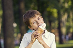 Boy eating ice cream Stock Image