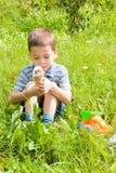 Boy eating ice cream on the nature. Child, little happy boy eating ice cream on the nature Royalty Free Stock Photos