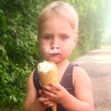 A boy is eating an ice cream stock images