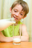 Boy eating ice cream. Young boy eating a tasty ice cream outdoors Royalty Free Stock Images