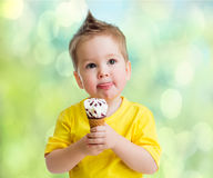 Boy eating icecream Stock Photos