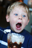 Boy eating icecream royalty free stock photography