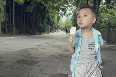 Boy eating icecream Stock Image