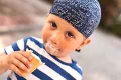 Boy eating icecream Stock Photos