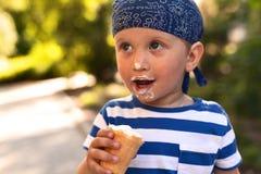 Boy eating icecream Stock Images