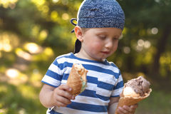 Boy eating icecream Stock Image