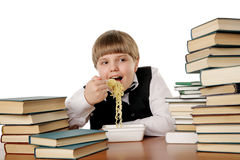 Boy eating instant noodles Royalty Free Stock Image