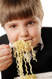 Boy eating instant noodles Stock Photo