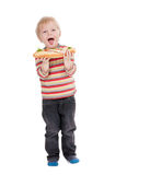 Boy eating large sandwich on white background Royalty Free Stock Photography