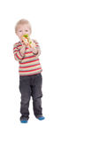 Boy eating large sandwich on white background Royalty Free Stock Image