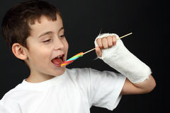 Boy eating lollipop Stock Images